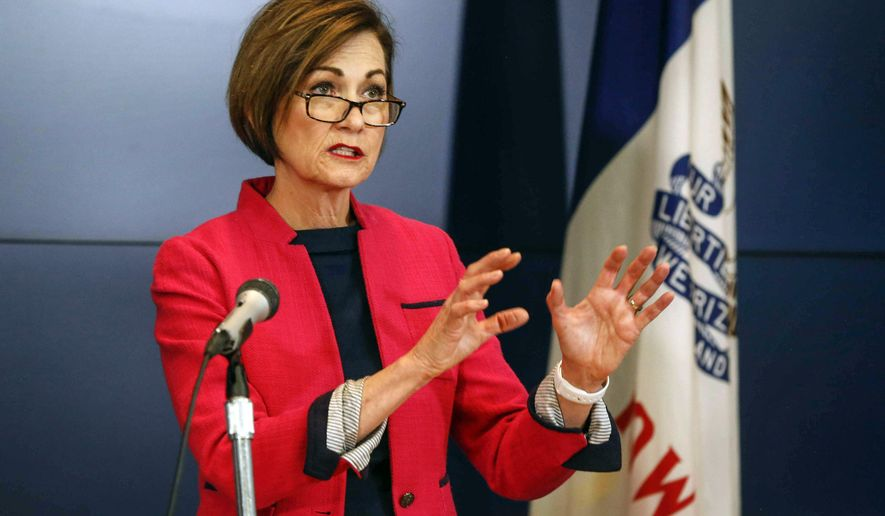 Iowa Gov. Kim Reynolds gave an update on the status of new COVID-19 cases in Iowa during a press conference at the Iowa National Guard in Johnston, Friday, Friday, May 1, 2020. (Bryon Houlgrave/The Des Moines Register via AP, Pool)