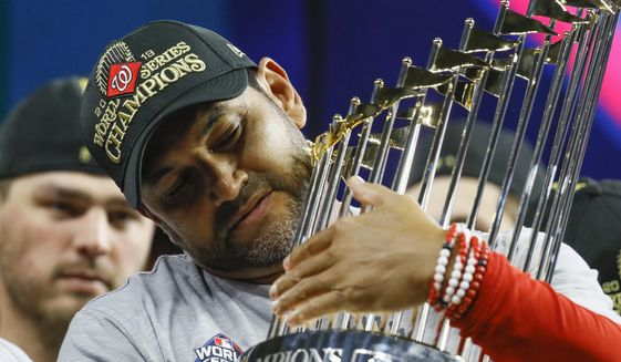 In this Oct. 30, 2019, file photo, Washington Nationals manager Dave Martinez celebrates after Game 7 of the baseball World Series against the Houston Astros in Houston.  (AP Photo/Matt Slocum, File)  **FILE**