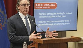 North Dakota Governor Doug Burgum issues budget guidelines to North Dakota state agencies for the 2021-23 biennium at a press briefing on Friday morning, May 1, 2020 at the state capitol in Bismarck, N.D.. Gov. Burgum was joined at the briefing by Office of Management & Budget director Joe Morrissette. (Tom Stromme/The Bismarck Tribune via AP)