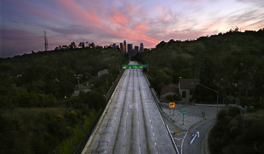 Empty lanes of the 110 Arroyo Seco Parkway that leads to downtown Los Angeles is seen during the coronavirus outbreak, Sunday, April 26, 2020, in Los Angeles, Calif. (AP Photo/Mark J. Terrill)