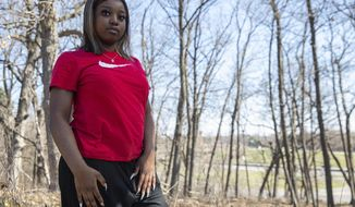 Patricia Bass, 19, pictured in Minnetonka, Minn., on Saturday, April 25, 2020, wants to graduate from high school in the spring. But without stable housing and a pandemic that has forced schools to closed, Bass, said it's hard to stay motivated. (Evan Frost/Minnesota Public Radio via AP)