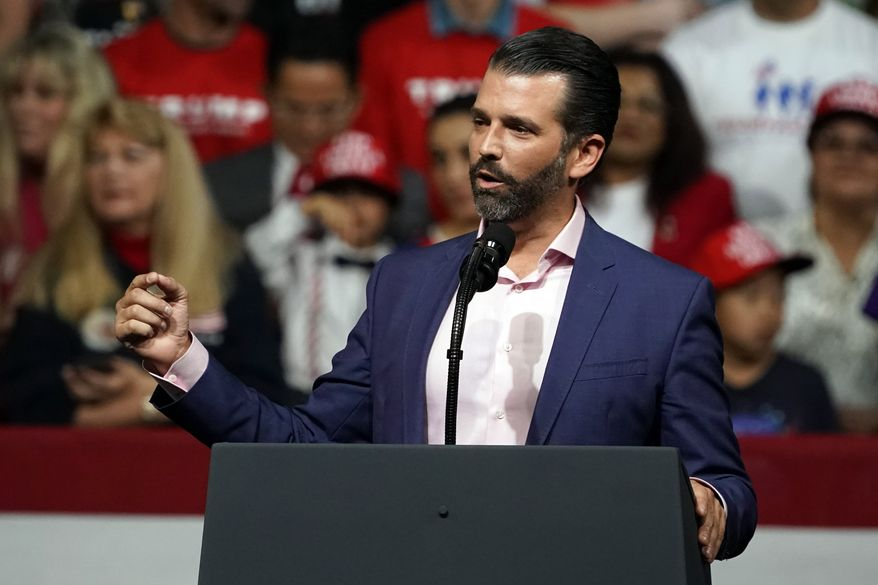 Donald Trump Jr. speaks at a rally before his dad and President Donald Trump appears in Phoenix, Feb. 19, 2020. (AP Photo/Rick Scuteri) ** FILE **