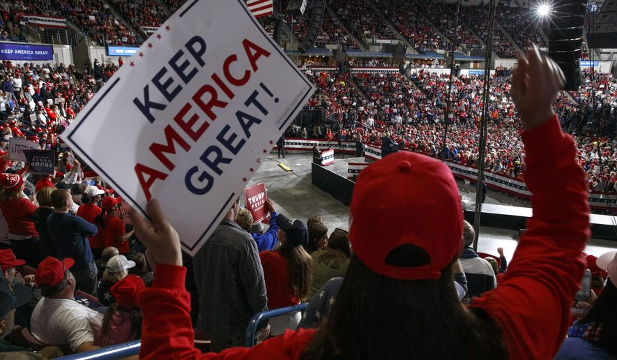 In this Feb. 28, 2020, file photo, supporters of President Donald Trump cheer as he speaks during a campaign rally in North Charleston, S.C. (AP Photo/Jacquelyn Martin, File)