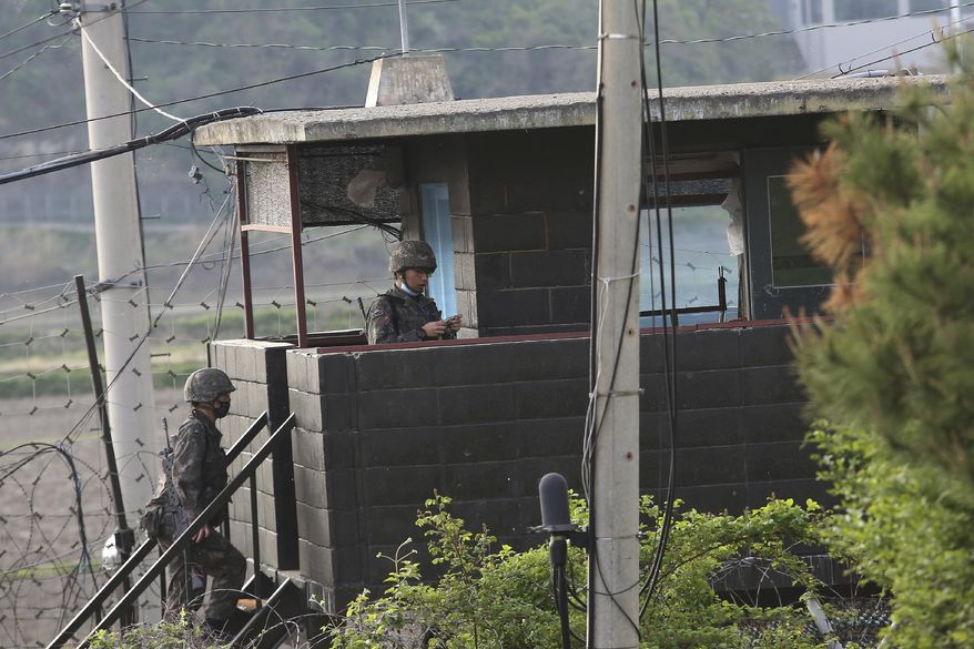 In this file photo, South Korean soldiers walk up the stairs of their military guard post in Paju, South Korea, near the border with North Korea, Sunday, May 3, 2020.  (AP Photo/Ahn Young-joon)  **FILE**