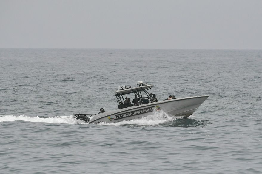 Security forces patrol in the port city of La Guaira, Venezuela, Sunday, May 3, 2020. Interior Nestor Reverol said on state television that security forces overcame before dawn Sunday an armed maritime incursion with speedboats from neighboring Colombia in which several attackers were killed and others detained. (AP Photo/Matias Delacroix)