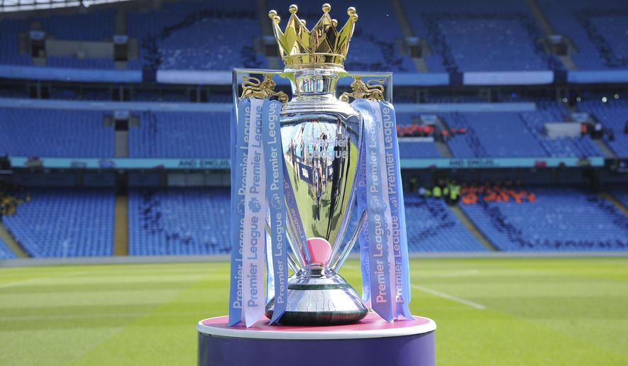 FILE - In this Sunday, May 6, 2018 file photo, the English Premier League trophy is displayed on the pitch prior to the English Premier League soccer match between Manchester City and Huddersfield Town at Etihad stadium in Manchester, England. Steve Parish, the chairman of Crystal Palace, says the Premier League could face years of legal challenges if this season is not completed due to the coronavirus pandemic. (AP Photo/Rui Vieira, File)