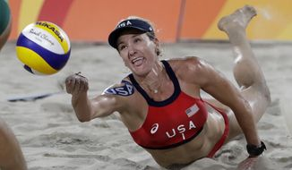 In this Aug. 17, 2016, file photo, United States' Kerri Walsh Jennings digs for a ball while playing Brazil during the women's beach volleyball bronze medal match of the Summer Olympics in Rio de Janeiro, Brazil. (AP Photo/Marcio Jose Sanchez, File)