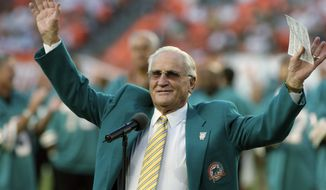 In this Oct. 25, 2009, file photo, former Miami Dolphins head coach Don Shula waves to the crowd during a half time ceremony of an NFL football game between the Miami Dolphins and the New Orleans Saints in Miami. Shula, who won the most games of any NFL coach and led the Miami Dolphins to the only perfect season in league history, died Monday, May 4, 2020, at his South Florida home, the team said. He was 90. (AP Photo/Jeffrey M. Boan) ** FILE **