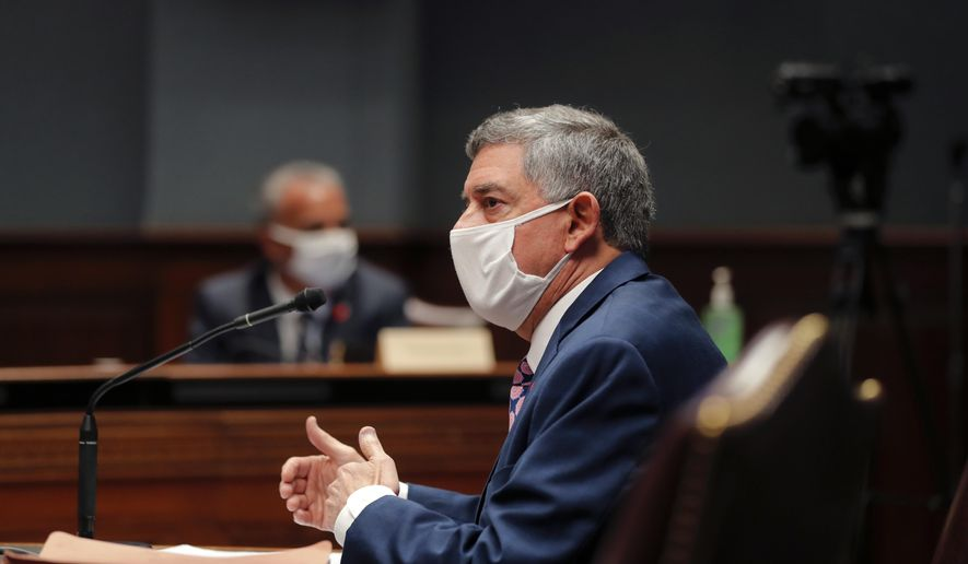 State commissioner of administration Jay Dardenne wears a mask as he testifies before the Louisiana House Appropriations Committee, in Baton Rouge, La., Monday, May 4, 2020. (AP Photo/Gerald Herbert)