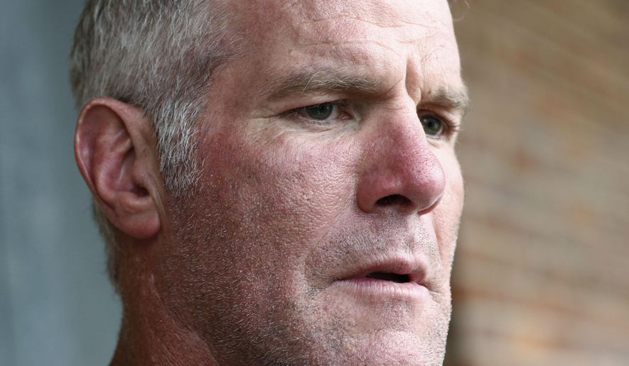 In this Oct. 17, 2018, file photo, former NFL quarterback Brett Favre speaks with reporters in Jackson, Miss., about his support for Willowood Developmental Center, a facility that provides training and assistance for special needs students,T he Mississippi state auditor's office said in a report it released Monday, May 4, 2020, that a nonprofit group used welfare money to pay $1.1 million to Favre for multiple speaking engagements but Favre did not show up for the events. Favre was paid $500,000 in December 2017 and $600,000 in June 2018, according to an audit of the Mississippi Department of Human Services. Favre is not charged with any wrongdoing. (AP Photo/Rogelio V. Solis, File)
