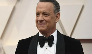 FILE In this Feb. 9, 2020 file photo Tom Hanks arrives at the Oscars at the Dolby Theatre in Los Angeles. The actor delivered a surprise virtual speech Saturday, May 2 to performing arts graduates of Wright State University in Dayton, Ohio. (Photo by Richard Shotwell/Invision/AP)
