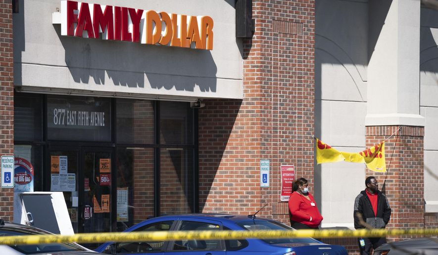 In this Friday, May 1, 2020, file photo, employees stand outside the Family Dollar as police investigate a shooting that took place at the store in Flint, Mich. (Sarahbeth Maney/The Flint Journal via AP) ** FILE **