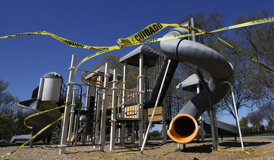FILE - In this April 2, 2020, file photo, caution tape surrounds the playground at Country Side Community Park in Elk Grove, Calif. (AP Photo/Rich Pedroncelli, File)