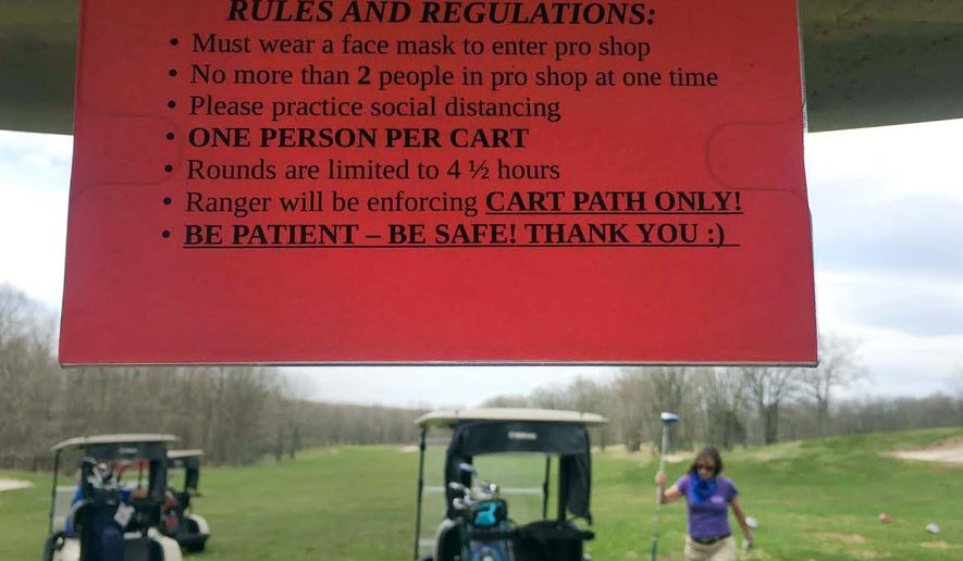 A sign explaining new COVID-19 golf rules greets golfers at the Wilkes Barre Municipal Golf Course in Bear Creek, Pa., Saturday, May 2, 2020. Pennsylvania Gov. Tom Wolfe lifted the prohibition on golfing Friday. (Dave Scherbenco/The Citizens' Voice via AP)