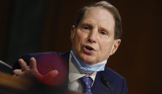 Sen. Ron Wyden, D-Ore., speaks during a Senate Intelligence Committee nomination hearing for Rep. John Ratcliffe, R-Texas, on Capitol Hill in Washington, Tuesday, May 5, 2020. (AP Photo/Andrew Harnik, Pool) ** FILE **