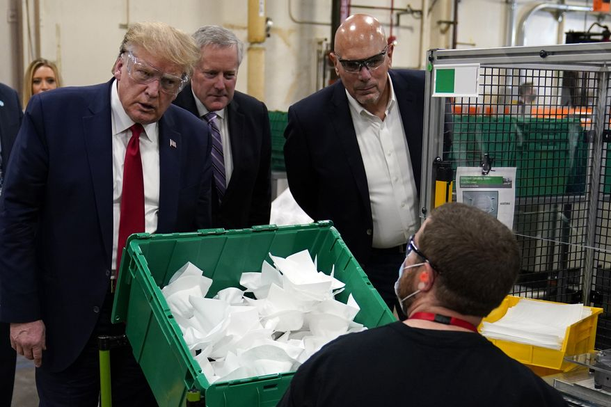 President Donald Trump participates in a tour of a Honeywell International plant that manufactures personal protective equipment, Tuesday, May 5, 2020, in Phoenix. (AP Photo/Evan Vucci)