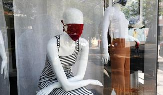 "Mannequins wear masks, a reference to the new coronavirus, inside a newly opened clothing store in Asuncion, Paraguay, Monday, May 4, 2020. The government authorized the opening of some stores under the plan coined ""Intelligent quarantine."" (AP Photo/Jorge Saenz)"