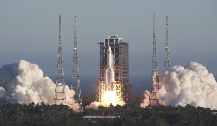 In this photo released by Xinhua News Agency, China's new large carrier rocket Long March-5B blasts off from the Wenchang Space Launch Center in southern China's Hainan Province, May 5, 2020. The Long March-5B made its maiden flight on Tuesday, sending the trial version of China's new-generation manned spaceship and a cargo return capsule for test into space. (Tu Haichao/Xinhua via AP)