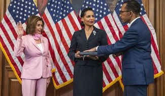 House Speaker Nancy Pelosi of Calif., conducts a ceremonial swearing-in for Rep. Kweisi Mfume, D-Md., accompanied by his wife Tiffany Mfume, center, at the U.S. Capitol, Tuesday, May 5, 2020, in Washington. Baltimore Democrat Kweisi Mfume was sworn-in as Maryland's newest congressman succeeding the late Elijah Cummings. (AP Photo/Manuel Balce Ceneta)