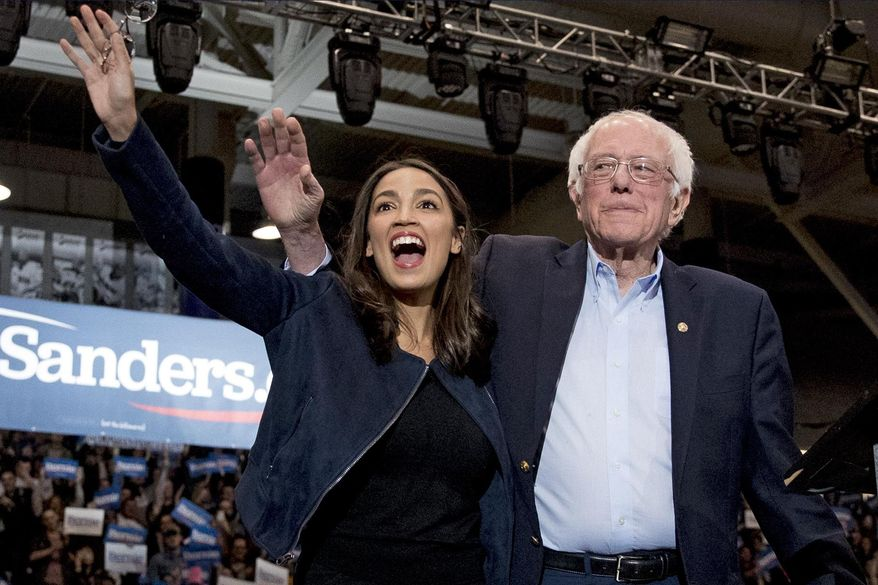 In this Feb. 10, 2020, file photo, Democratic presidential candidate Sen. Bernie Sanders, I-Vt., right, and Rep. Alexandria Ocasio-Cortez, D-N.Y. wave to supporters at a campaign stop at Whittemore Center Arena at the University of New Hampshire in Durham, N.H. On Tuesday, May 5, federal Judge Analisa Torres ruled that the New York Democratic presidential primary must take place June 23 because canceling it would be unconstitutional. (AP Photo/File, Andrew Harnik)