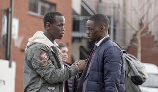 "This image released by Paramount Pictures shows Micheal Ward as Marco, left, and Stephen Odubola as Timmy in a scene from ""Blue Story."" (Nick Wall/Paramount Picture via AP)"