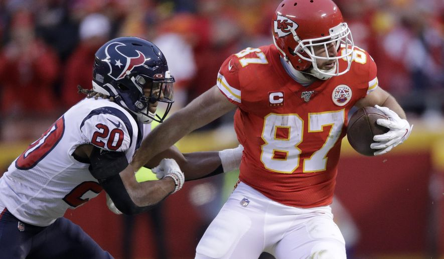 FILE - In this Jan. 12, 2020, file photo, Kansas City Chiefs tight end Travis Kelce (87) is tackled by Houston Texans safety Justin Reid during the second half of an NFL divisional playoff football game in Kansas City, Mo. Kelce has two years remaining on a five-year, $46.8 million extension that he signed in 2016. (AP Photo/Charlie Riedel, File)
