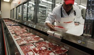 In this Dec. 8, 2009 file photo, a butcher places beef on display at Costco in Mountain View, Calif. (AP Photo/Paul Sakuma, file)  **FILE**