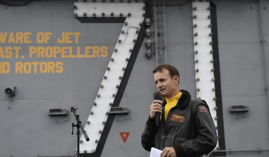 In this Nov. 15, 2019, photo, U.S. Navy Capt. Brett Crozier, then commanding officer of the aircraft carrier USS Theodore Roosevelt (CVN 71), addresses the crew during an all-hands call on the ship's flight deck while conducting routine operations in the Eastern Pacific Ocean. (U.S. Navy Photo by Mass Communication Specialist 3rd Class Nicholas Huynh via AP) ** FILE **