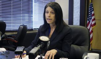 In this March 5, 2020 file photo, Michigan Attorney General Dana Nessel addresses the media during a news conference, in Lansing, Mich. Nessel on Tuesday, May 5, 2020, is backing Gov. Gretchen Whitmer, telling local law enforcement officials that her stay-at-home directive and restrictions on places of public accommodations are valid and enforceable. Tuesday's letter comes days after Republican lawmakers refused to extend an emergency declaration. (AP Photo/David Eggert, File)