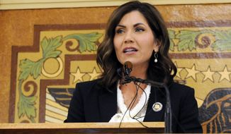In this Jan. 8, 2019 file photo, South Dakota Gov. Kristi Noem gives her first State of the State address in Pierre, S.D. While many other governor's have broken from President Donald Trump on stay-at-home orders to curb the spread of coronavirus or when to restart economic activity, Noem has tracked close to the president.  (AP Photo/James Nord, File)