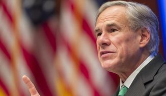 Texas Gov. Greg Abbott announced his plan to reopen the state's economy amid the coronavirus pandemic, Tuesday, May 5, 2020, in Austin. (Ricardo B. Brazziell/Austin American-Statesman via AP)