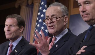 Senate Minority Leader Charles Schumer of N.Y., center, flanked by Sen. Richard Blumenthal, D-Conn., left, and Sen. Sheldon Whitehouse, D-R.I., right, speaks about the nomination of Supreme Court nominee Neil Gorsuch during a news conference on Capitol Hill in Washington, Wednesday, March 29, 2017. (AP Photo/Susan Walsh) **FILE**