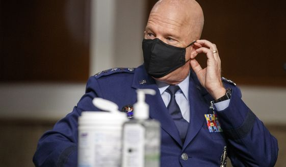 Gen. John W. Raymond, chief of space operations, is fighting the COVID-19 pandemic while defending the country. (Associated Press/File)