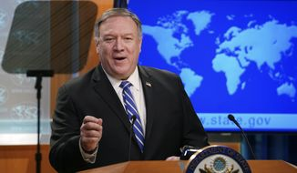 Secretary of State Mike Pompeo speaks a news conference at the State Department in Washington on Wednesday, May 6, 2020. (Kevin Lamarque/Pool Photo via AP)