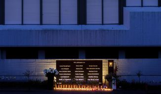 Candles for the 18 victims are lit at the memorial in front of the Joseph-Konig-Gymnasium, Tuesday, March 24, 2020, in Haltern am See, Germany. Five years ago on March 24, 2015, the Germanwings Airbus flight number 4U9525 crashed on a mountain in the Alps and all 150 passengers onboard died. Among the dead were 16 students and two teachers from Haltern, who came from a student exchange in Spain. (Rolf Vennenbernd/dpa via AP)