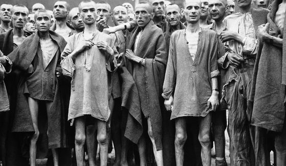 This May 7, 1945, file photo shows emaciated prisoners at one of the largest Nazi Concentration camps at Evensee Austria, in the Austrian Alps. (AP Photo, File)
