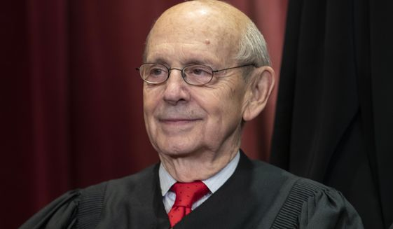 In this Nov. 30, 2018, file photo Associate Justice Stephen Breyer, appointed by President Bill Clinton, sits with fellow Supreme Court justices for a group portrait at the Supreme Court Building in Washington. (AP Photo/J. Scott Applewhite, File)