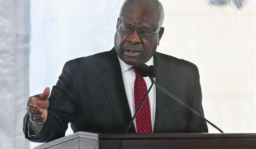 FILE - In this Feb. 11, 2020, file photo, Supreme Court Justice Clarence Thomas delivers a keynote speech during a dedication of Georgia new Nathan Deal Judicial Center in Atlanta. A Supreme Court justice gets it in his mind to ask a question, and pretty soon, he's got questions for everyone. And so the next question: Will Clarence Thomas ever stop talking? Before this week, the intervals between Thomas' questions during high court arguments were measured in years. He once went 10 years, from 2006 to 2016, without asking even one.  (AP Photo/John Amis, File)