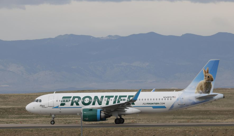 In this April 23, 2020, file photo, a Frontier Airlines jetliner taxis to a runway for take off from Denver International Airport in Denver. Lawmakers on Capitol Hill lashed out Wednesday, May 6, 2020, against Frontier Airlines over the budget carrier's move to charge passengers extra to guarantee they will sit next to an empty middle seat while flying during the coronavirus outbreak. (AP Photo/David Zalubowski)
