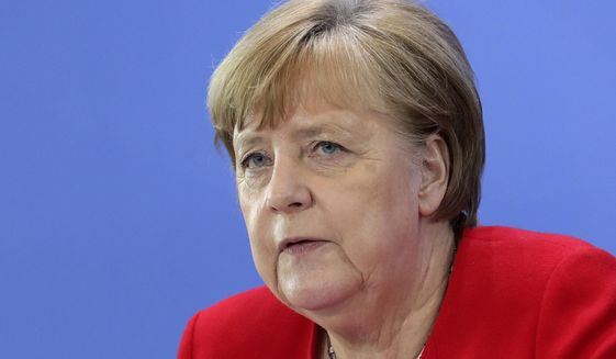 German Chancellor Angela Merkel attends a press conference in Berlin, Germany, Wednesday, May 6, 2020 after an online meeting of Merkel and the German state governors on the loosening of the restictions to reduce the spread of the new coronavirus. (AP Photo/Michael Sohn, pool)