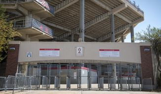 In this Saturday, April 18, 2020, file photo, Gate 2 at Memorial Stadium is empty because the annual Red-White matchup was cancelled due to the coronavirus pandemic. The goal is for all of major college football _ 130 teams in 10 conferences across 41 states _ to start a season at the same time and play an equal number of games. It is becoming more apparent the coronavirus pandemic is going to make that goal difficult to achieve. (Francis Gardler/Lincoln Journal Star via AP, File)  **FILE**