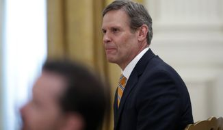 Tennessee Gov. Bill Lee listens as President Donald Trump speaks about protecting seniors, in the East Room of the White House, Thursday, April 30, 2020, in Washington. (AP Photo/Alex Brandon)