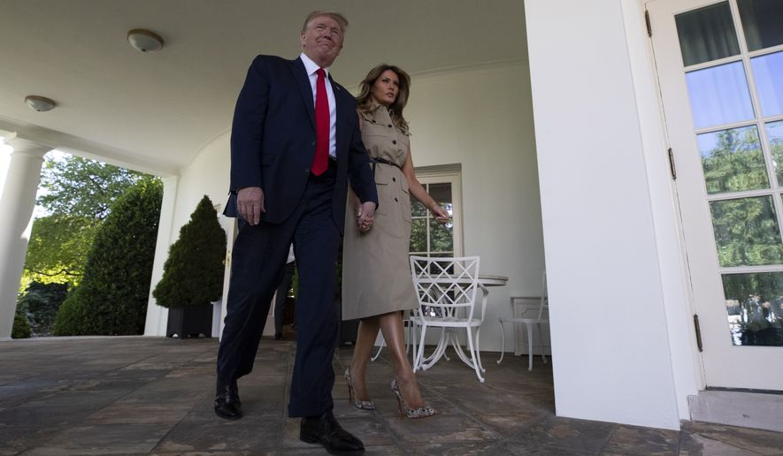 President Donald Trump and first Lady Melania Trump arrive for a White House National Day of Prayer Service in the Rose Garden of the White House, Thursday, May 7, 2020, in Washington. (AP Photo/Alex Brandon)