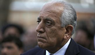 In this March 9, 2020, file photo, Washington's peace envoy Zalmay Khalilzad attends the inauguration ceremony for Afghan President Ashraf Ghani at the presidential palace in Kabul, Afghanistan.  (AP Photo/Rahmat Gul, File) **FILE**