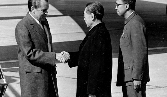 FILE - In this Feb. 21, 1972, file photo, Ji Chaozhu, right, stands near then Chinese Premier Zhou Enlai, center, greeting then U.S. President Richard Nixon at Beijing Airport in Beijing. Ji, a veteran Chinese diplomat who provided English translation for leaders from Mao Zedong to Deng Xiaoping and served as an undersecretary of the United Nations, has died on April 29 in Beijing, the foreign ministry said late Wednesday, May 6, 2020. He was 90. (AP Photo, File)