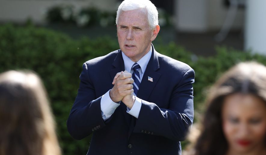 Vice President Mike Pence speaks to attendees after a White House National Day of Prayer Service in the Rose Garden of the White House, Thursday, May 7, 2020, in Washington. (AP Photo/Alex Brandon)