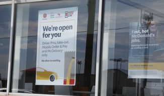 A sign in the window at a McDonald's restaurant states no dine-in seating Thursday, May 7, 2020, in Oklahoma City, where three McDonald's employees suffered gunshot wounds when a customer opened fire because she was angry that the restaurant's dining area was closed because of the coronavirus pandemic, on Wednesday. (AP Photo/Sue Ogrocki)