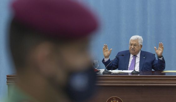 Palestinian President Mahmoud Abbas heads the Palestinian leadership meeting at his headquarters, in the West Bank city of Ramallah, Tuesday, May 5, 2020. (AP Photo/Nasser Nasser, Pool)
