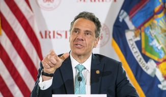 In this photo provided by the Office of Governor Andrew M. Cuomo, Gov. Cuomo briefs the media at Marist College, Friday, May 8, 2020, in Poughkeepsie, N.Y. (Darren McGee/Office of Governor Andrew M. Cuomo via AP) ** FILE **