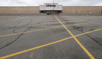 A parking lot at a JC Penney store is empty in Roseville, Mich., Friday, May 8, 2020. Across the country, in industries of every kind and size, the coronavirus pandemic has devastated businesses small and large. (AP Photo/Paul Sancya)